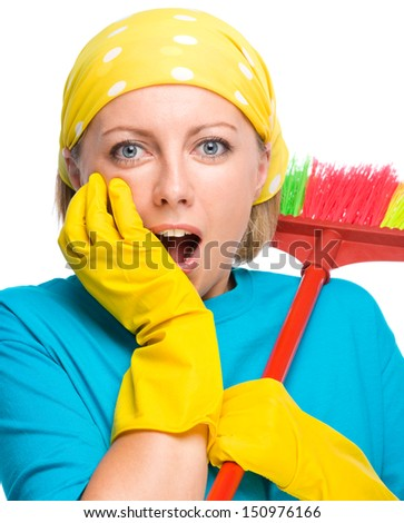 Young woman - cleaning maid with broom holding her face in astonishment, isolated over white - stock photo