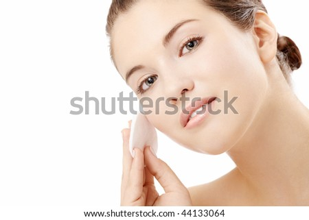 Young woman clears a face skin, isolated - stock photo