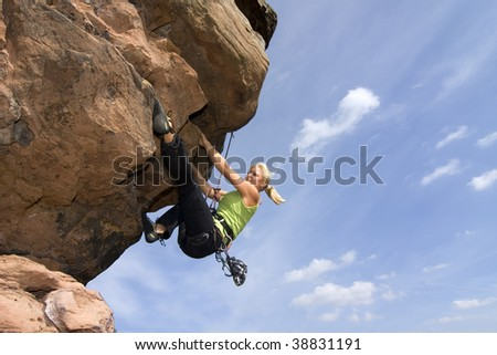 Young woman climbing an extreme rock - Charlotte Frank at the Windstein - Vosges - France - stock photo