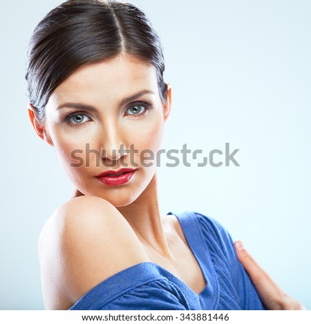 Young woman close up face portrait with naked shoulder, blue dress. Red lips. isolated studio portrait in beauty style.