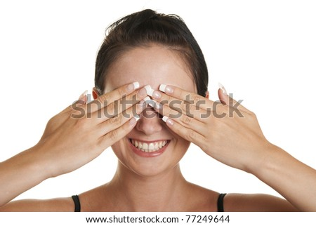 Young woman closes eyes palms isolated in white