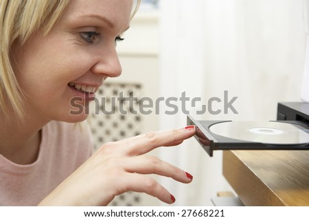 Young Woman Closing DVD Player With Finger