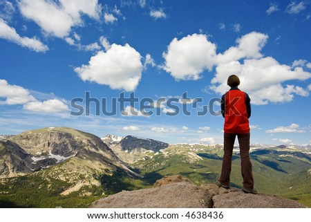 Young woman contemplating a beautiful landscape. Rocky Mountain National Park, Colorado. USA. - stock photo