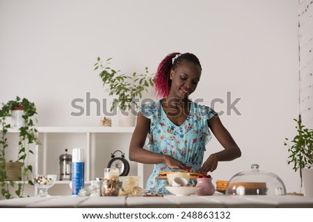 Young Woman Cooking at home. Healthy Food. Dessert Concept. Healthy Lifestyle. Cooking At Home. Prepare Food - stock photo