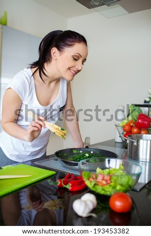 Young Woman Cooking. Healthy Food - Vegetable Salad. Diet. - stock photo