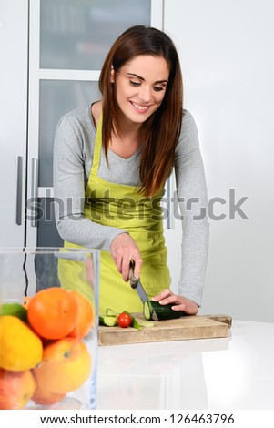 Young Woman Cooking. Healthy Food - Vegetable Salad. Diet. Dieting Concept. Healthy Lifestyle. Cooking At Home. Prepare Food