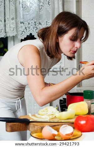 Young woman cooking healthy food with lots of vegetables