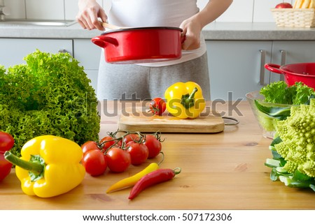young woman cooking healthy meal in the kitchen. Cooking healthy food at home