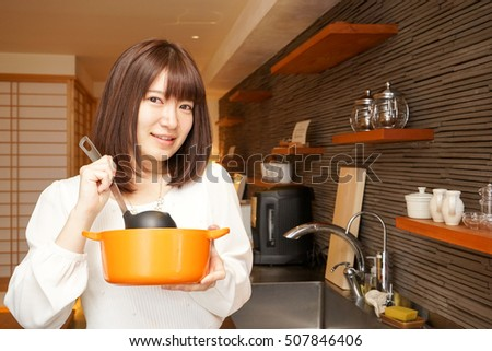 Young woman cooking in a Kitchen with smile