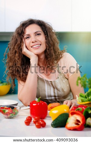 Young woman cooking in the kitchen healthy food, vegetable Salad.  Healthy lifestyle cooking at home.