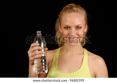 Young woman cooling down after exercise session. - stock photo