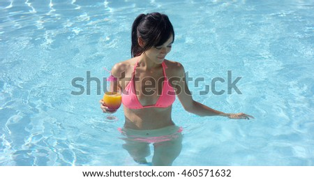 Young woman cooling off in a swimming pool