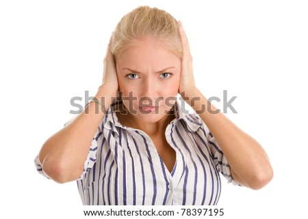 Young woman covering ears - stock photo