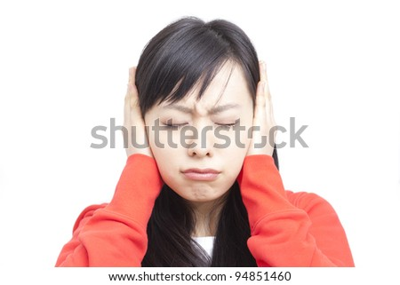 young woman covering ears with closed eyes , isolated on white background - stock photo