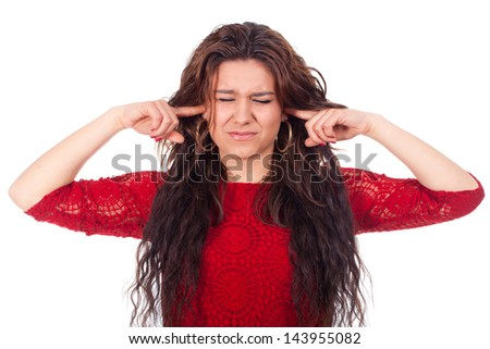 Young woman covering her ears and annoyed by so much noise - stock photo