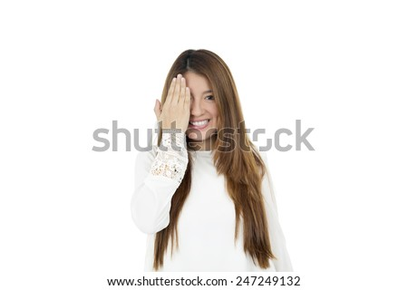 Young woman covering her eye with her hand against a white background - stock photo