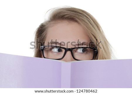 Young woman covering her face with book against white background - stock photo