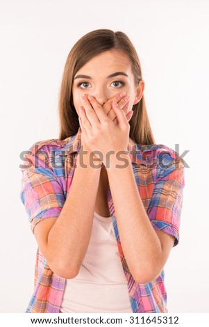 young woman covering her mouth - stock photo