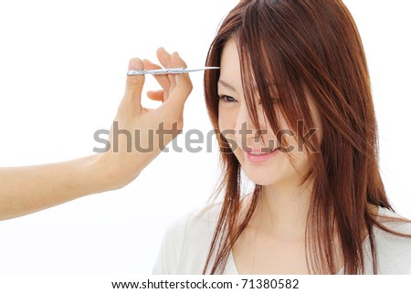 Young woman cutting hair - isolated - stock photo
