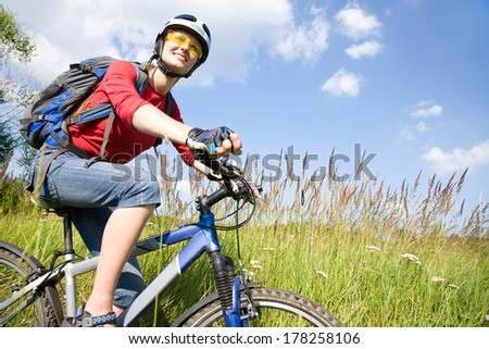 young woman cyclist in the park - stock photo