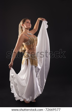 young woman dance in dark - white arabian costume