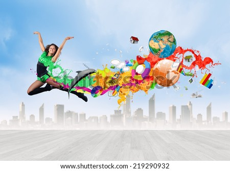 Young woman dancer in green suit jumping high
