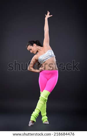 Young woman dancer. On dark background - stock photo