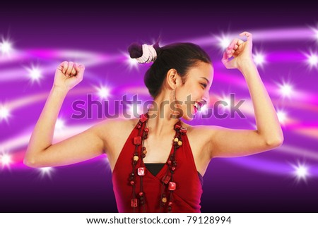 Young woman dancing at a nightclub with abstract purple and stars background - stock photo