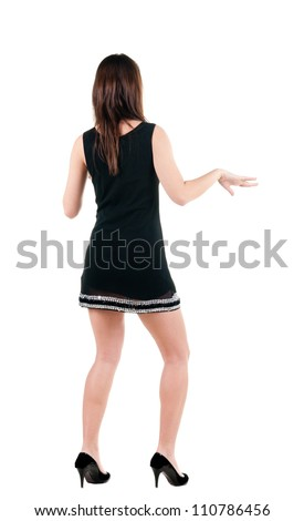 Young woman dancing. backside view of person. Isolated over white background. Rear view people collection. - stock photo