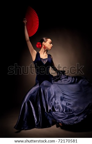 young woman dancing flameno on black - stock photo