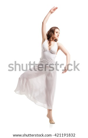Young woman dancing in dress over white