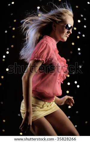 Young woman dancing in the nightclub - stock photo