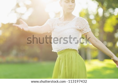 Young woman dancing on forest. Rear view - stock photo