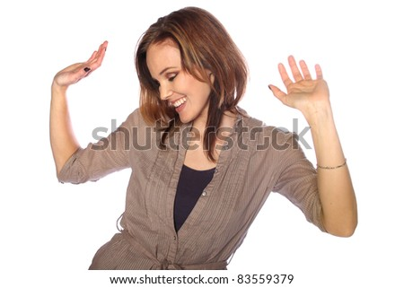 Young woman dancing to music - stock photo