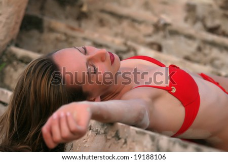 young woman dead on the old stairs - stock photo