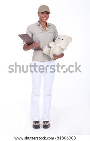 Young woman delivering a teddy bear - stock photo