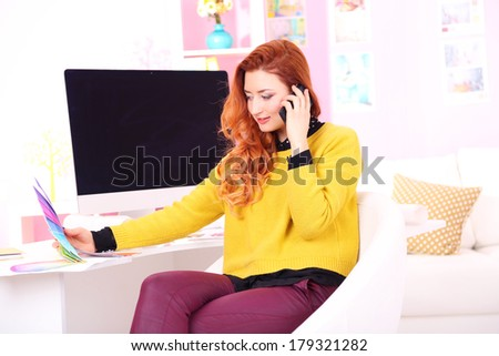 Young woman designer in workplace - stock photo
