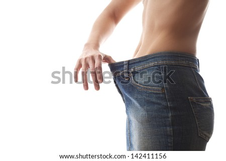 young woman dieting and contemplating weight loss wearing jeans gown on white background - stock photo
