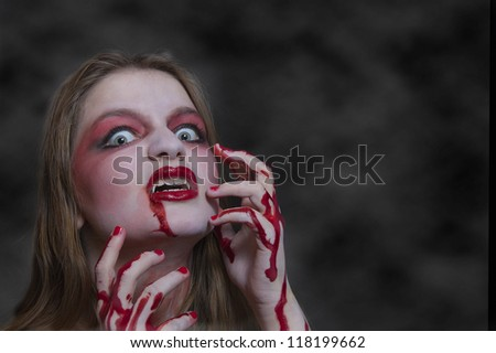 young woman disguised as a vampire for halloween - stock photo