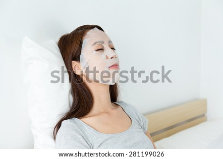 Young woman do masking - stock photo