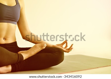 Young woman do yoga indoors - stock photo