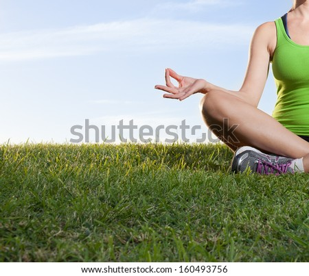 Young woman do yoga outdoors - stock photo