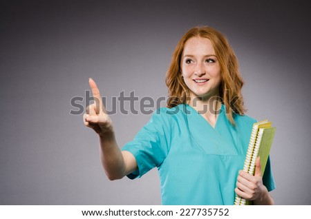 Young woman doctor in medical concept - stock photo