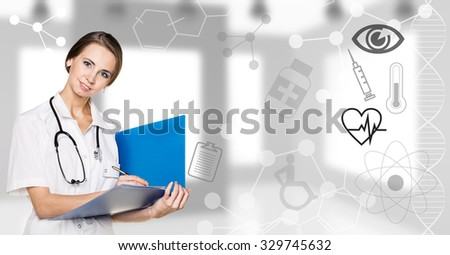 Young woman doctor stands with folder on the office background - stock photo