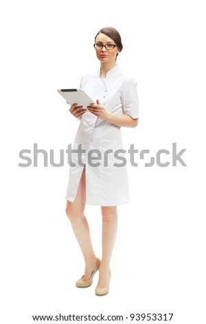 Young woman doctor wearing medical uniform using a touchscreen computer - stock photo