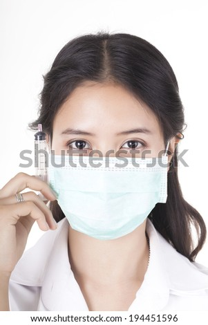 Young  woman doctor with syringe isolated on white - stock photo