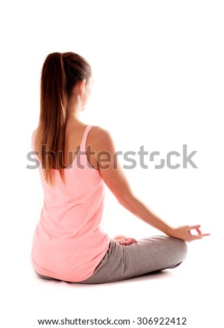 Young woman doing a meditation posture - stock photo