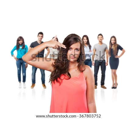 young woman doing a suicide gesture - stock photo
