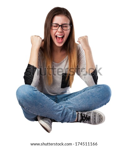 young woman doing a winner gesture isolated - stock photo