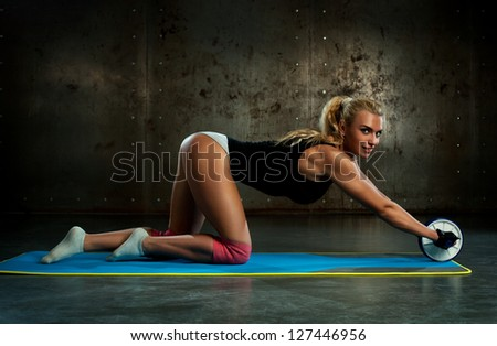 Young woman doing abdominal exercises.